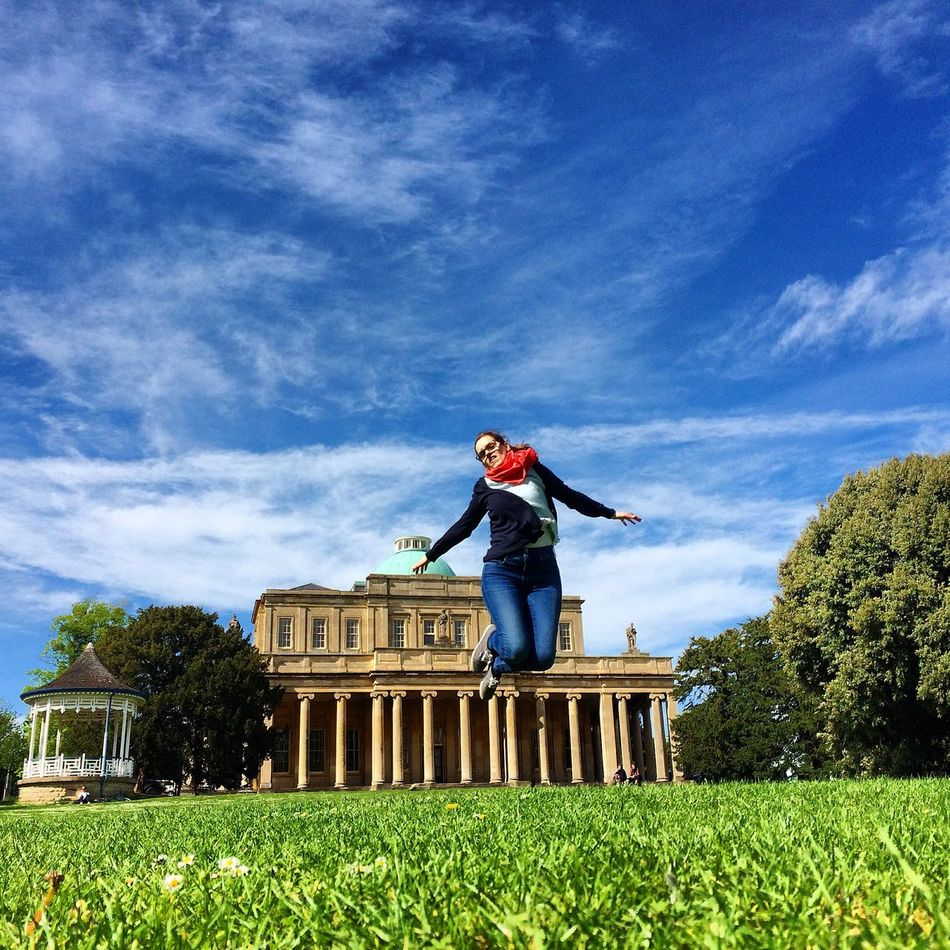 Pittville Park Garden Outdoor Grass Building Woman Jumping Cheltenham England