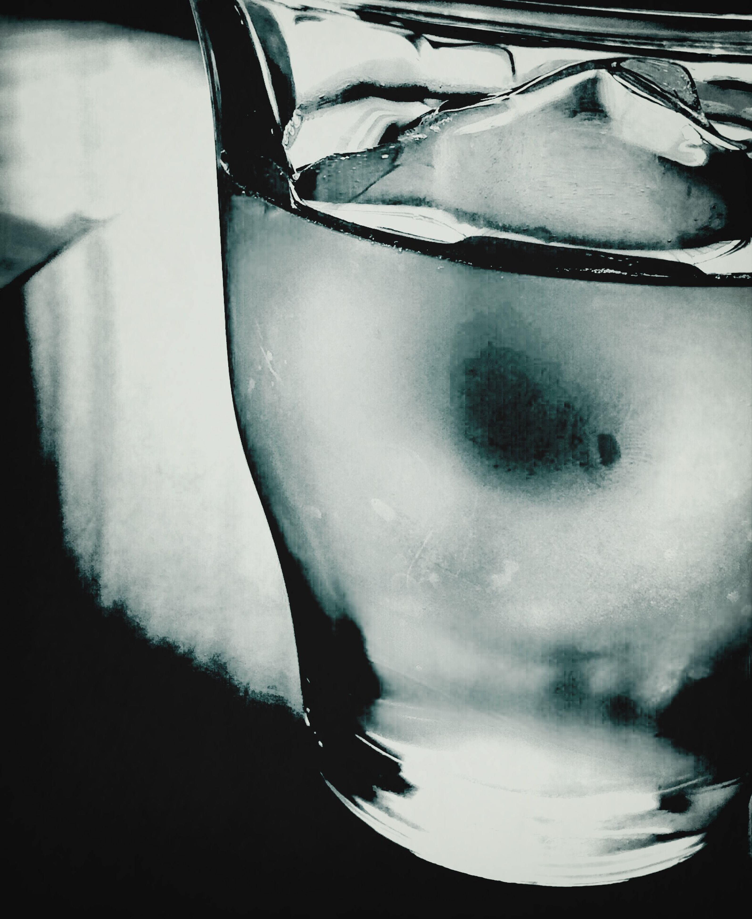 indoors, close-up, reflection, glass - material, still life, transparent, drinking glass, drink, part of, no people, refreshment, single object, high angle view, water, cropped, food and drink, day, table, mode of transport, focus on foreground