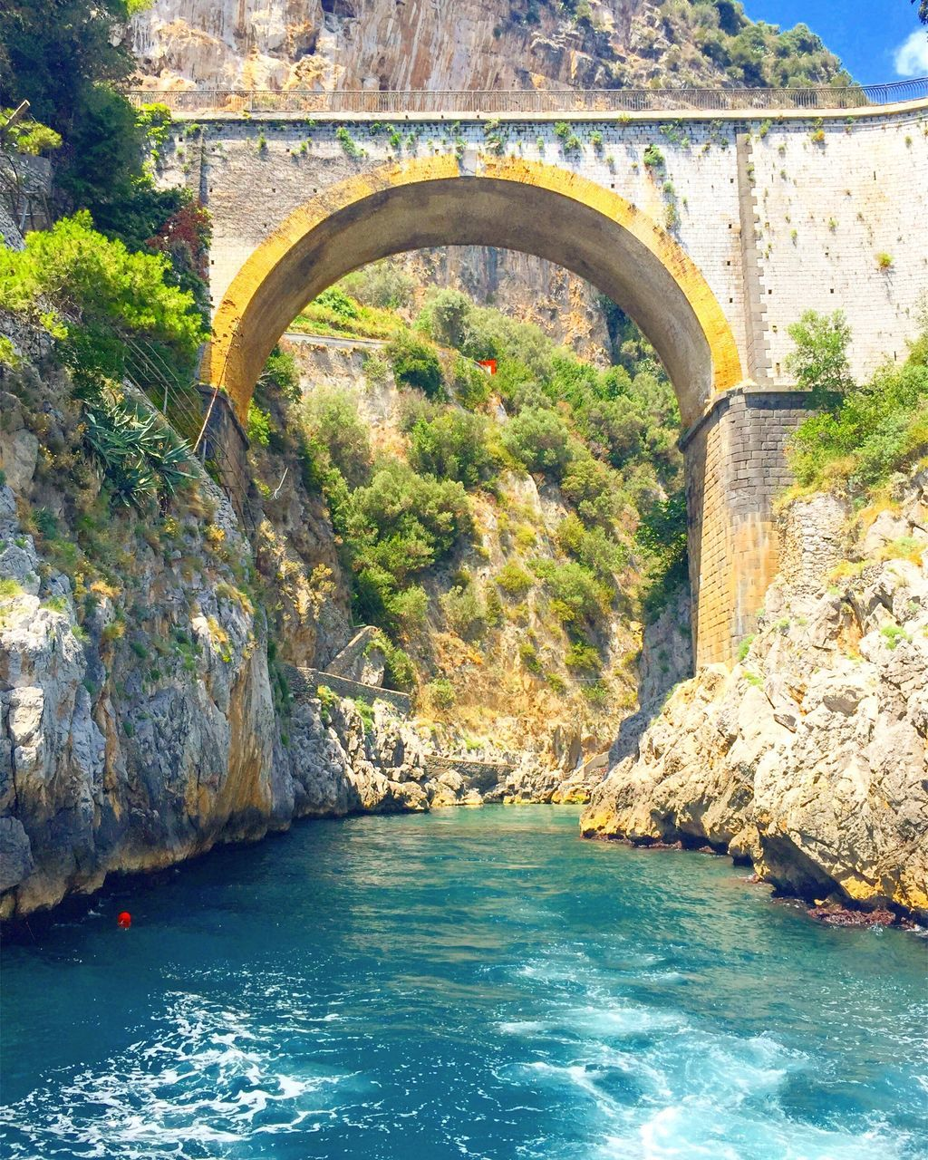 arch, water, rock - object, bridge - man made structure, day, nature, architecture, tranquility, scenics, outdoors, no people, travel destinations, beauty in nature, tree, sea