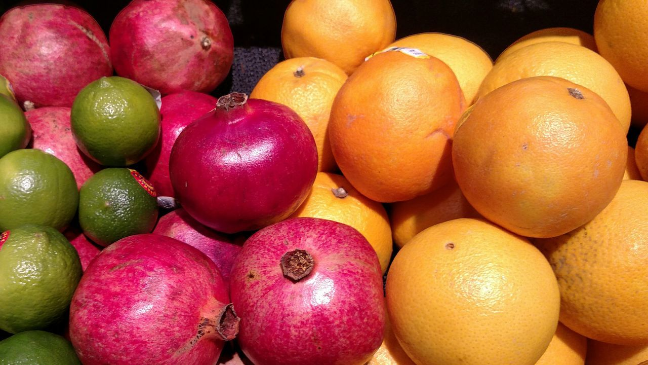 Orange Red Green Colourful Fall Colors Local Farmers Organic Fall Eating Cooking With Fresh Produce Grocery Shopping Organic Yummy Fruit Picture Local Farmers Bright Pomogranate Oranges Limes Fruit Lemons Lime Pomagranate