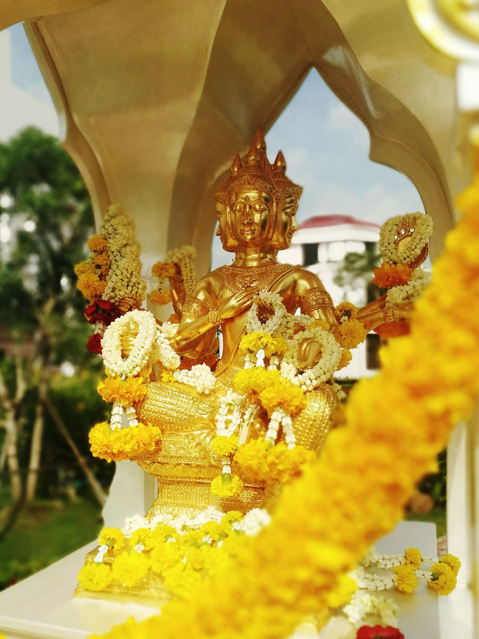 religion, statue, spirituality, art and craft, sculpture, male likeness, human representation, place of worship, flower, gold colored, indoors, no people, idol, day, close-up