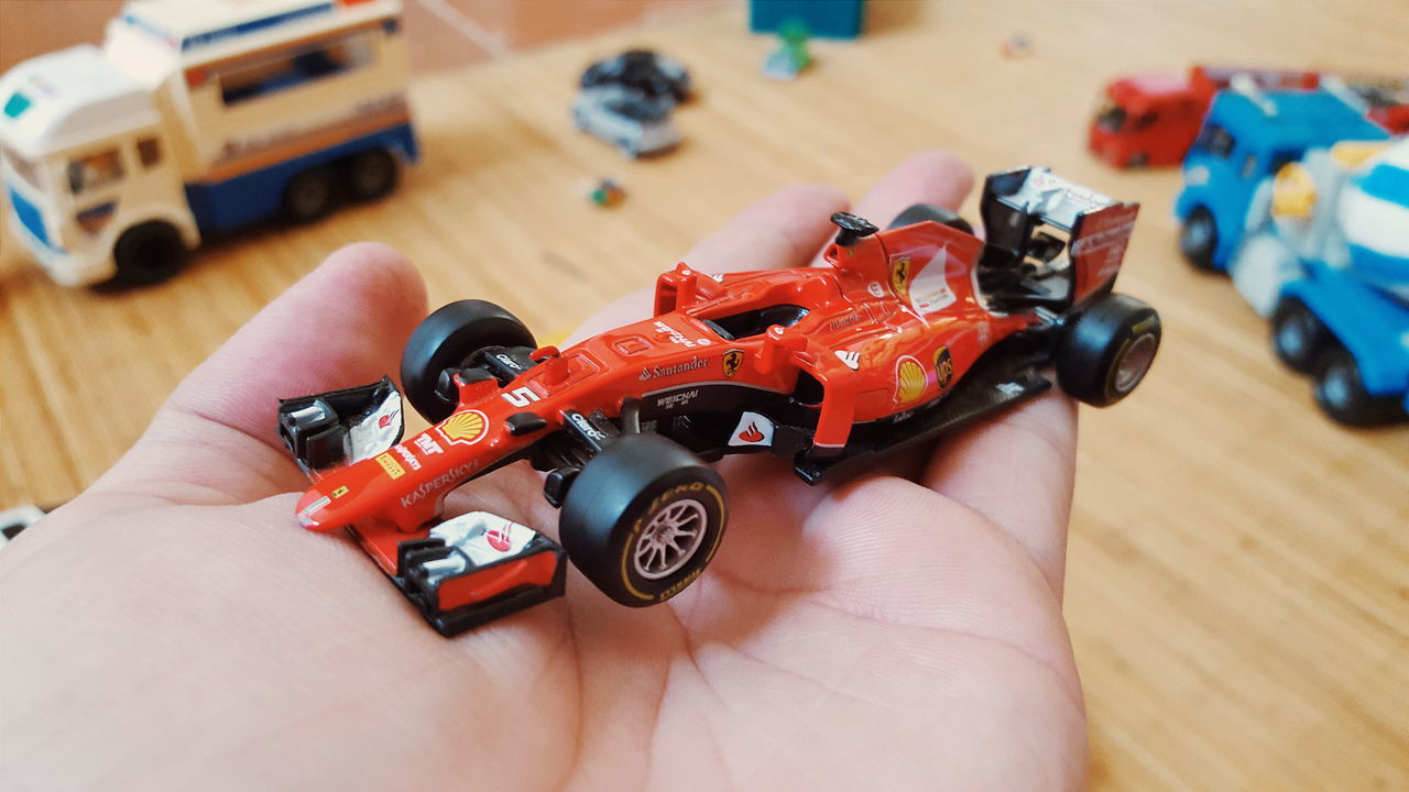Red Car Formula 1 Formula Car Formula1 Formula One Race Car Hand Palm Foreground Focus Background Blur Toys Kids Kids Toys Wheel HotWheels Miniature Car Miniature Diecast