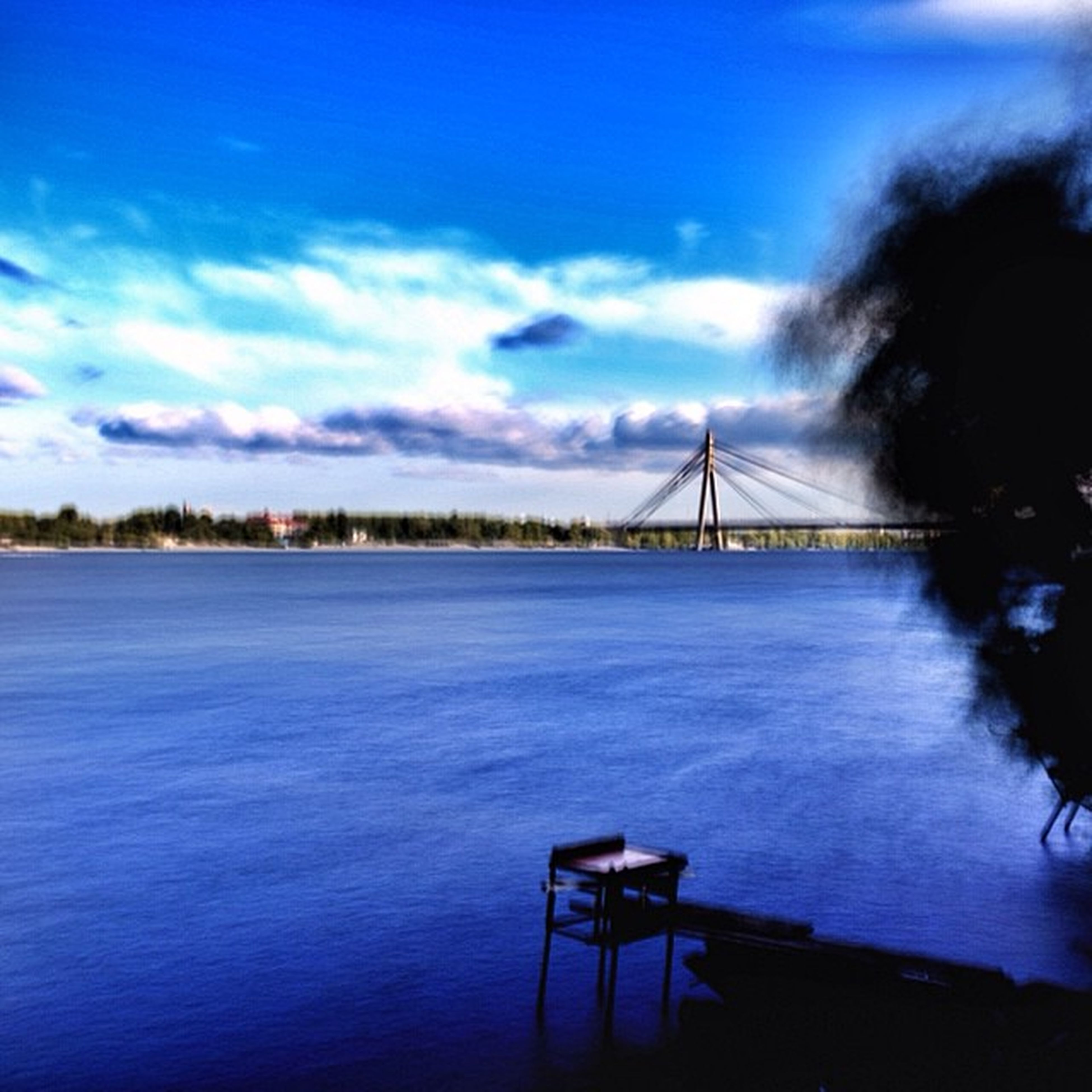 water, sky, blue, built structure, cloud - sky, sea, architecture, tranquility, tranquil scene, cloud, scenics, nature, beauty in nature, cloudy, connection, railing, river, travel destinations, bridge - man made structure, outdoors