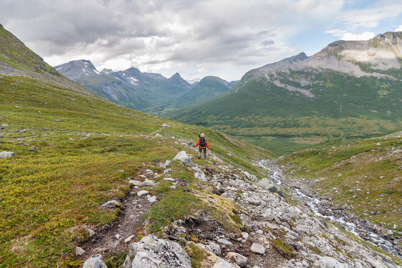 Dramatic Sky Norway Adventure Backpack Beauty In Nature Cloud - Sky Day Full Length Grass Hiking Landscape Leisure Activity Lifestyles Mountain Mountain Range Nature One Man Only One Person Outdoors Real People Scenics Sky Tranquil Scene Tranquility Travel
