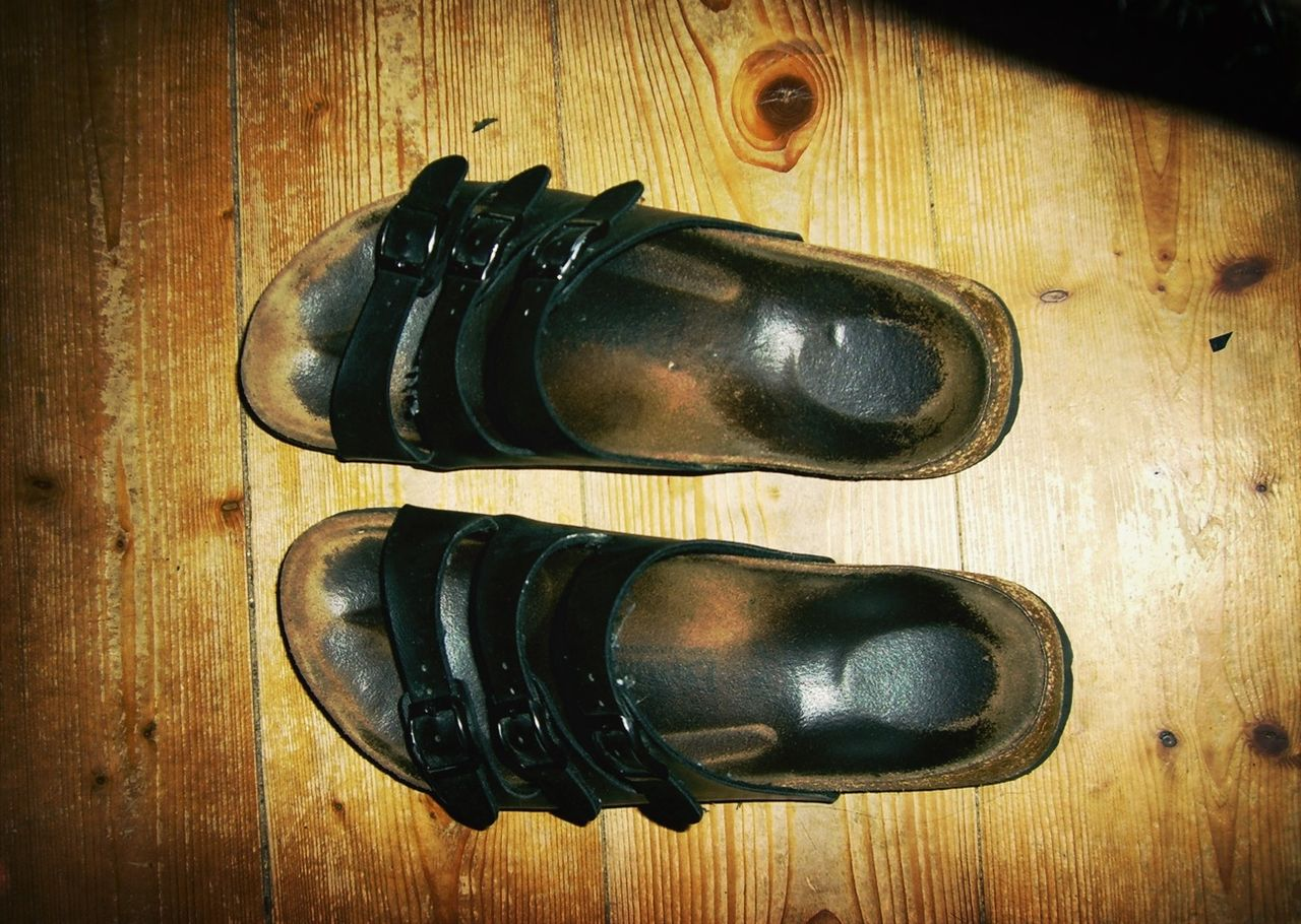 wood - material, indoors, table, shoe, no people, pair, black color, close-up, day