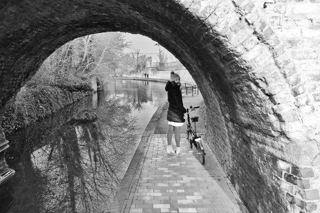 Blackandwhite B&w Bicycle Canal Tunnel Bridge Water Streetphoto_bw Streetphotography Portrait Of A Woman