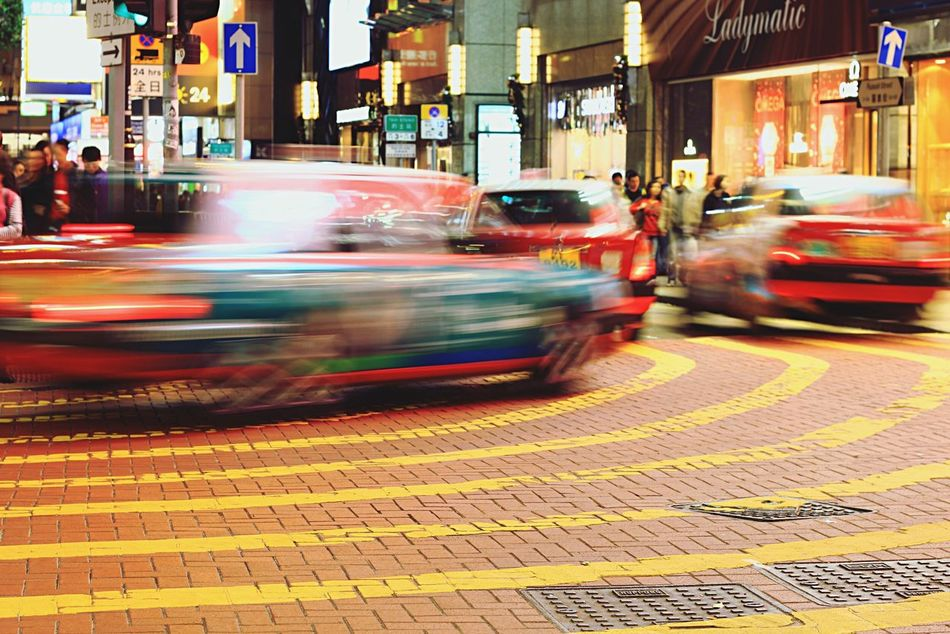Hustle and bustle Blurred Motion City Speed Street Night Motion City Street Illuminated Building Exterior City Life Architecture Travel Destinations Transportation Car Light Trail Land Vehicle Long Exposure Outdoors Hong Kong Taxi EyeEmNewHere Blur
