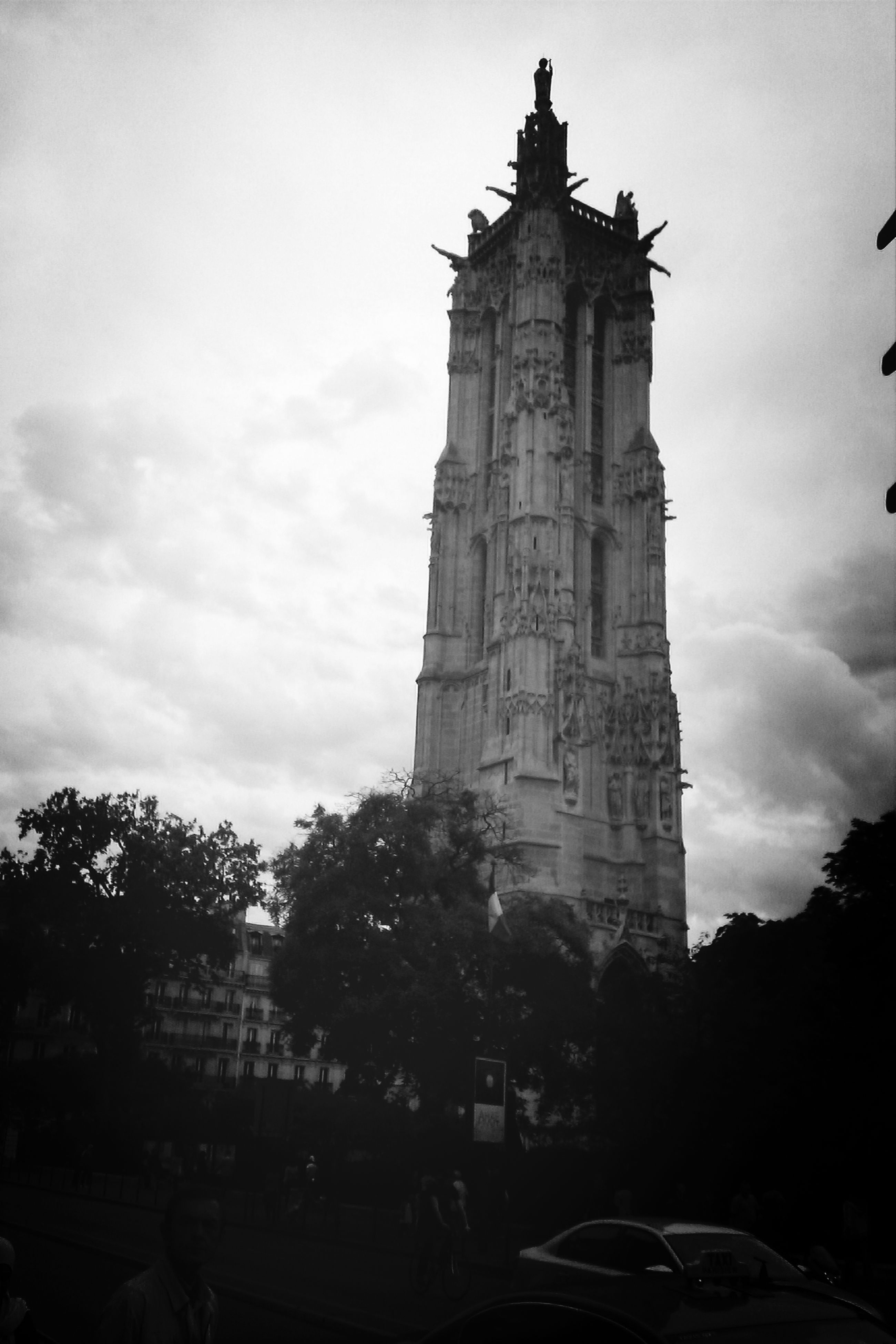 architecture, building exterior, built structure, sky, religion, place of worship, history, church, low angle view, spirituality, famous place, tree, cloud - sky, travel destinations, tower, travel, clock tower, cathedral