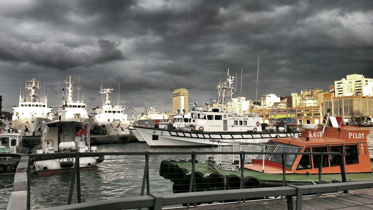 nautical vessel, cloud - sky, sky, transportation, moored, mode of transport, boat, water, building exterior, architecture, no people, built structure, harbor, outdoors, waterfront, sea, nature, day, storm cloud, mast, city, yacht, cityscape