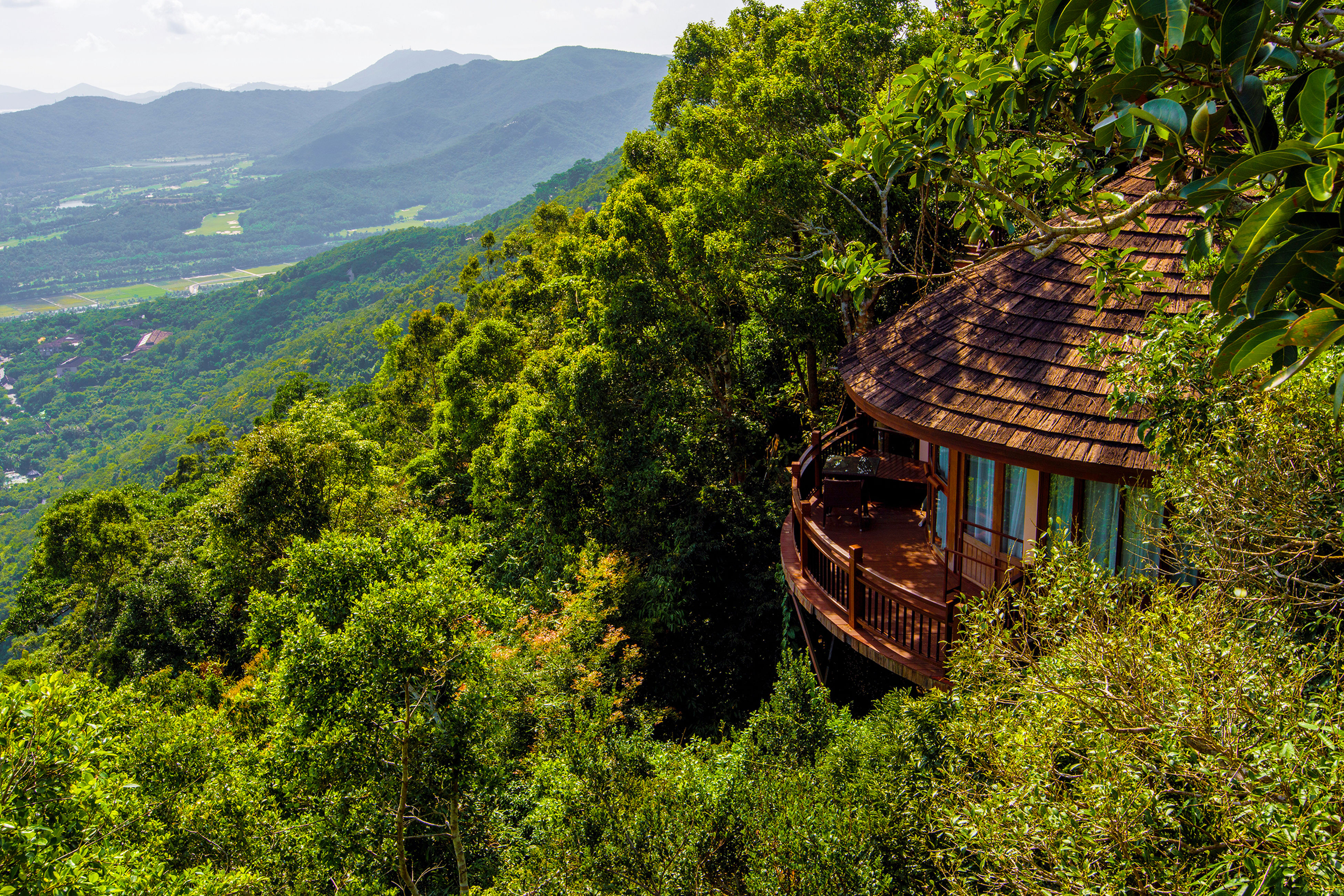 built structure, mountain, architecture, green color, tree, house, building exterior, tranquility, landscape, plant, tranquil scene, growth, nature, scenics, grass, lush foliage, abandoned, hill, beauty in nature, sky