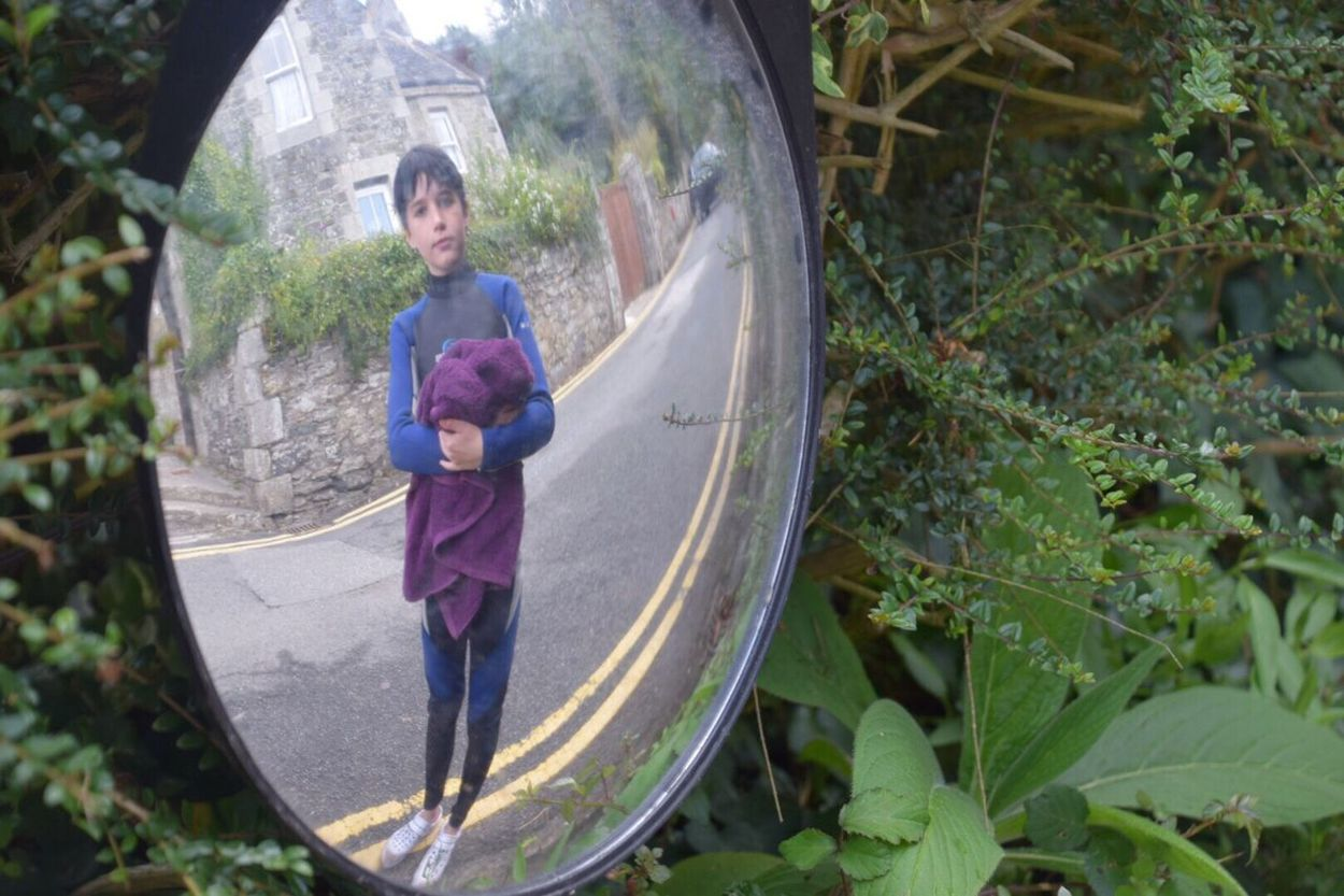 Heading Home St Mawes Harbour Cornwall Uk Childhood Sea Swimming Wetsuit One Person Day Boy Mirror Full Length Outdoors Casual Clothing Standing Holding Young Adult People Tree Nature