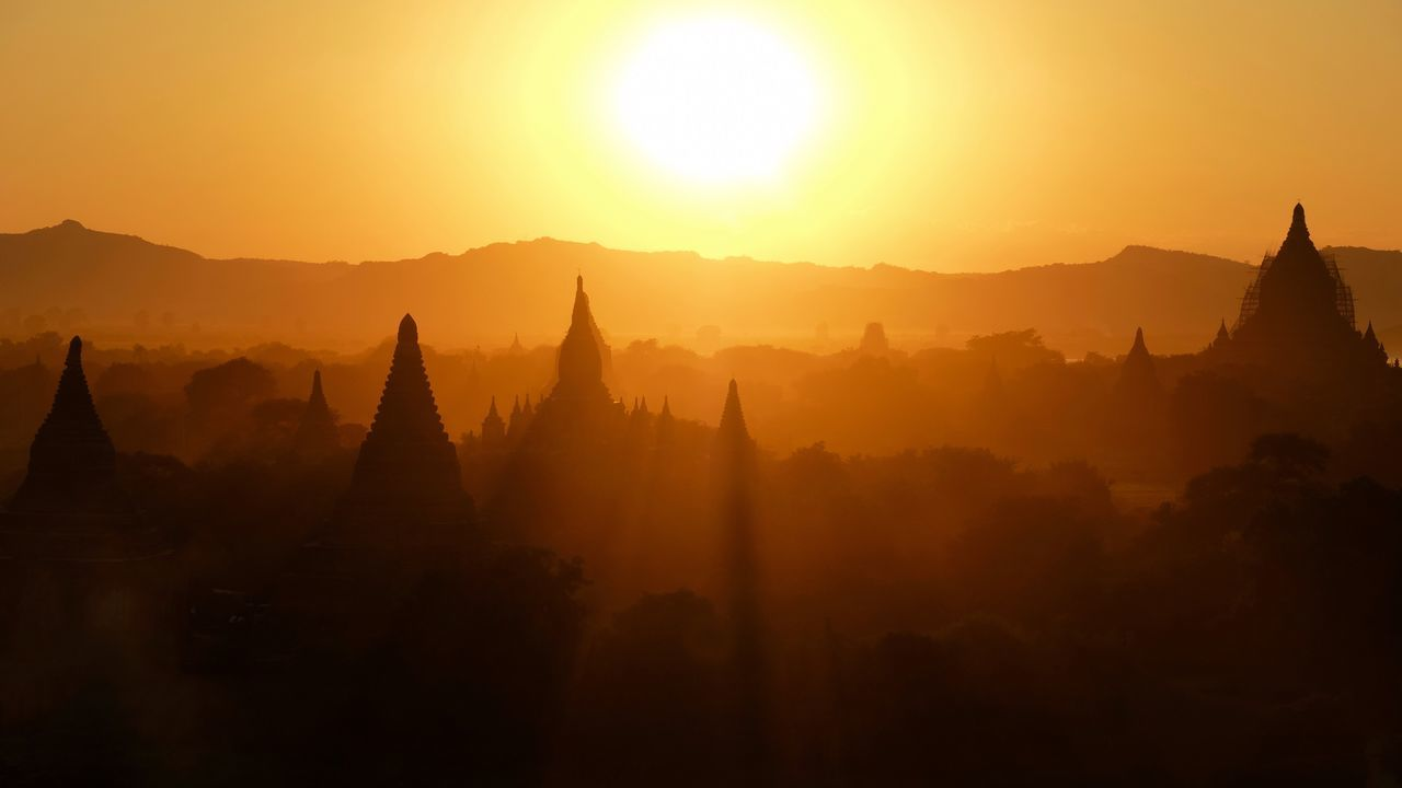 Architecture Religious Architecture Built Structure Sunlight Temple - Building Silhouette Historical Building Ancient Nature Travel Sun Spirituality Sunset Travel Destinations Sky No People Outdoors Mountain Cultures Beauty In Nature EyeEm Best Shots Check This Out Popular Photos in Bagan , Myanmar