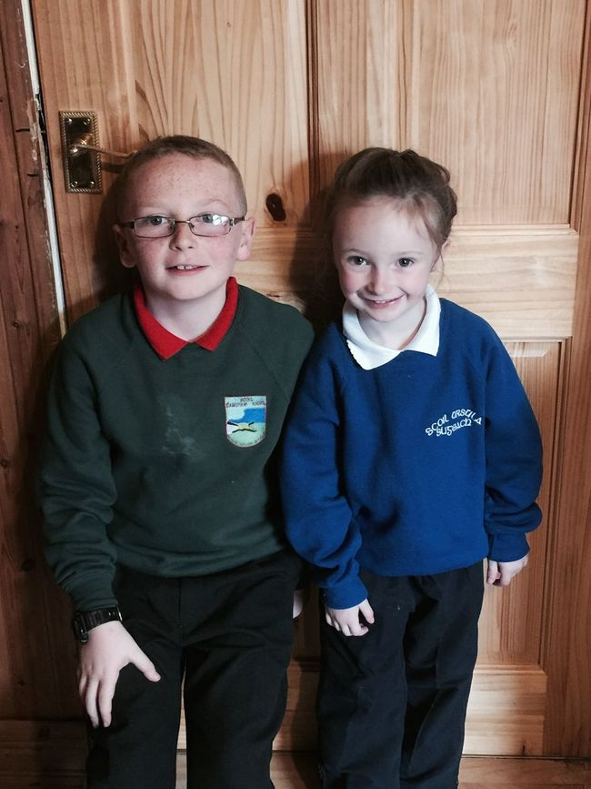 Cousins just in from good day at school