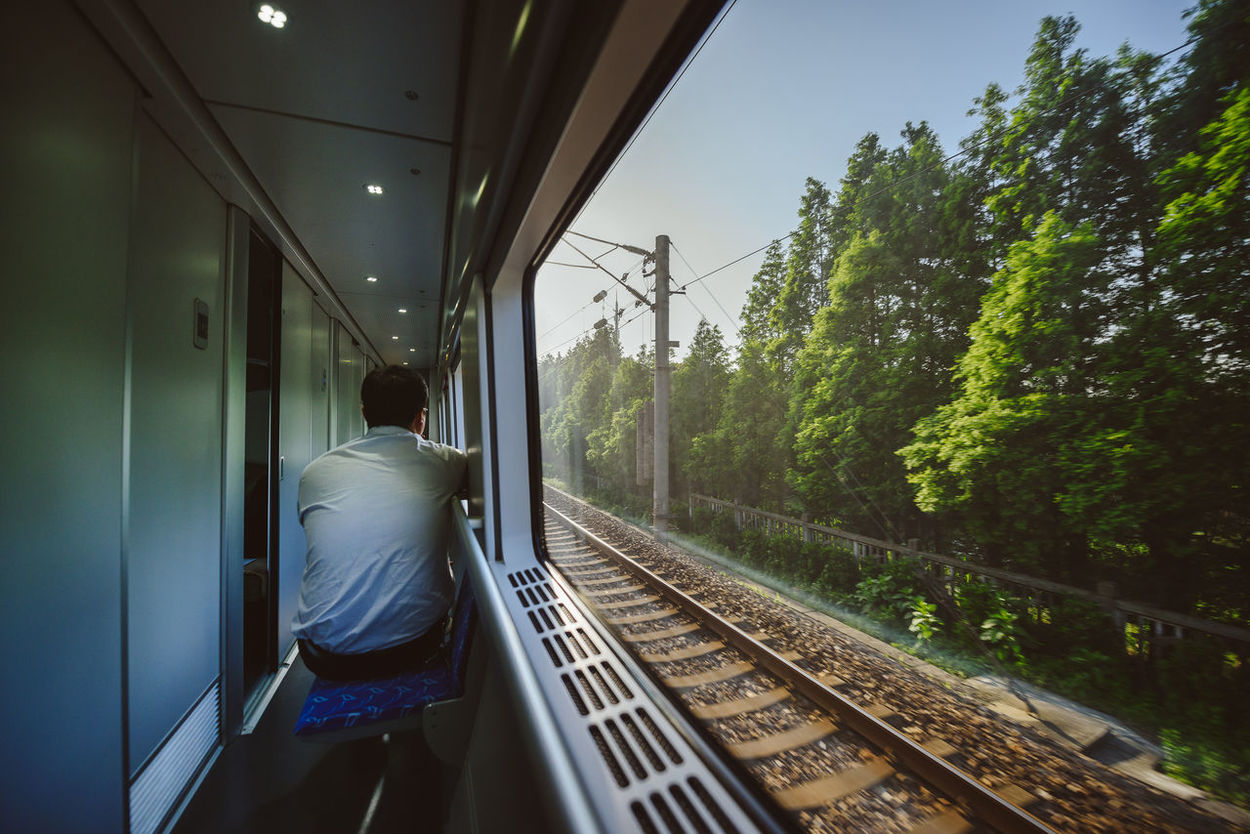Travelling Arriving Day Fast Train Local People Long Distance  Morning One Person Outdoors People Rear View Shanghai Sleeper Train Sunrise The Way Forward Transportation Traveller Travelling Photography Tree