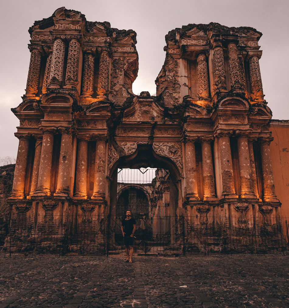 Ancient Ancient Civilization Antigua Architecture Beautiful Building Exterior Built Structure Central America Charm Church Cobblestone Colonial Culture Earthquake Evening Façade Guatemala History Man One Person Real People Rear View Ruin Sightseeing Travel Destinations