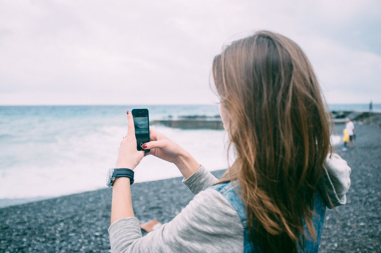 Beautiful stock photos of phone, Beach, Brown Hair, Close-Up, Coastline