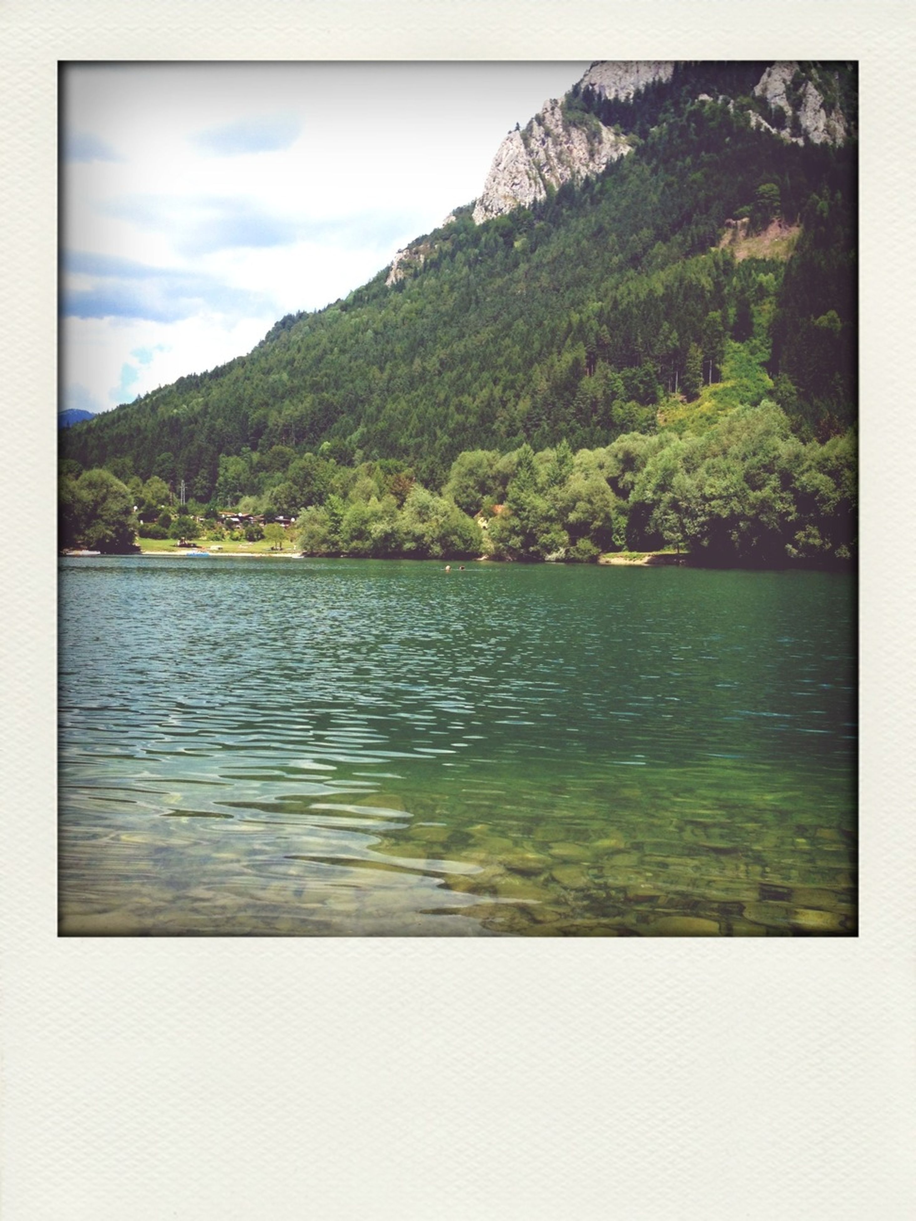 transfer print, water, tranquil scene, auto post production filter, mountain, scenics, tranquility, sky, beauty in nature, lake, nature, waterfront, tree, rippled, idyllic, mountain range, sea, cloud, cloud - sky, day