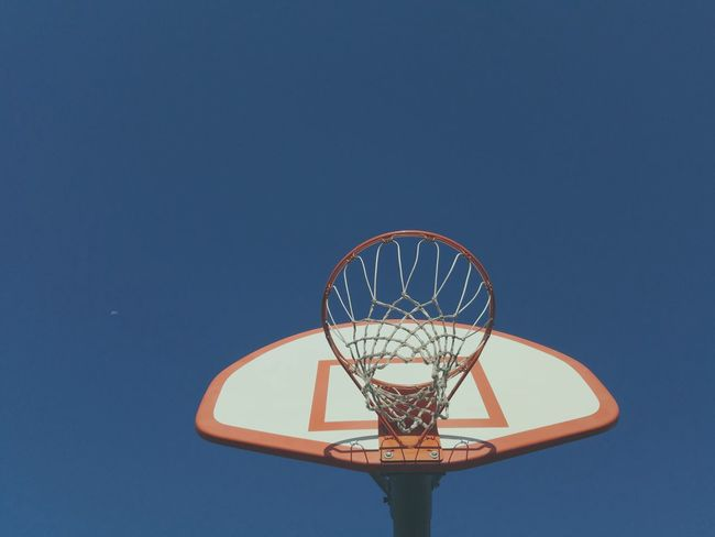 Basketball hoop at the playground. Basketball Basketball Hoop Retro Sky Net Orange White Blue Retro Styled Lookingup Cameraphone Android Personal Perspective Smartphone Photography Sports Playground Fun