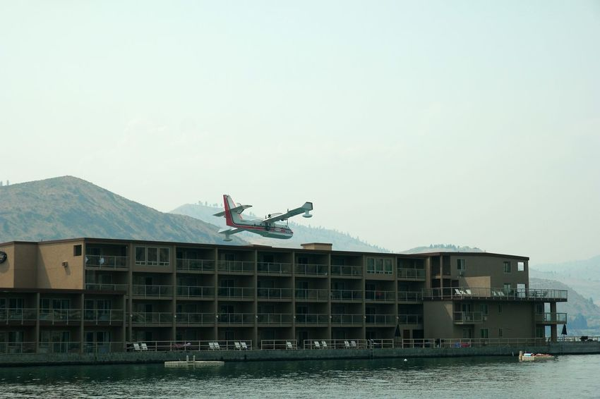 Airplane Plane Hotel Motel Condos Close Close Call Scary Too Close Too Close For Comfort Amazing Feat Skimming Crazy Crazy Moments Extreme The Photojournalist - 2016 EyeEm Awards Risky Risky Business Adventure Waterplane Lake Lake View FireFighting  Urban Lifestyle