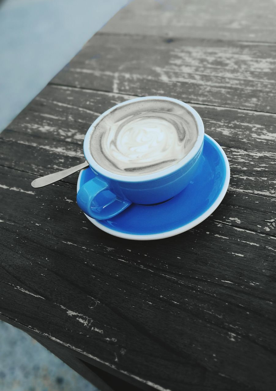 drink, food and drink, table, refreshment, coffee cup, coffee - drink, no people, blue, high angle view, indoors, freshness, frothy drink, wood - material, close-up, froth art, day, cappuccino
