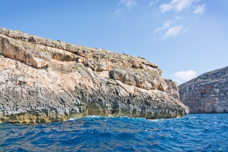 Limestone rocks with caves and clear turquoise water of popular tourist attraction Blue Grotto on a sunny day in September 15, 2015 in Malta. Blue Grotto Malta Mediterranean  Nature Nature Photography Rugged Travel Blue Day Destinations Landscape Maltese Nature_collection No People Ocean Outdoors Sea Seascape Turquoise Water