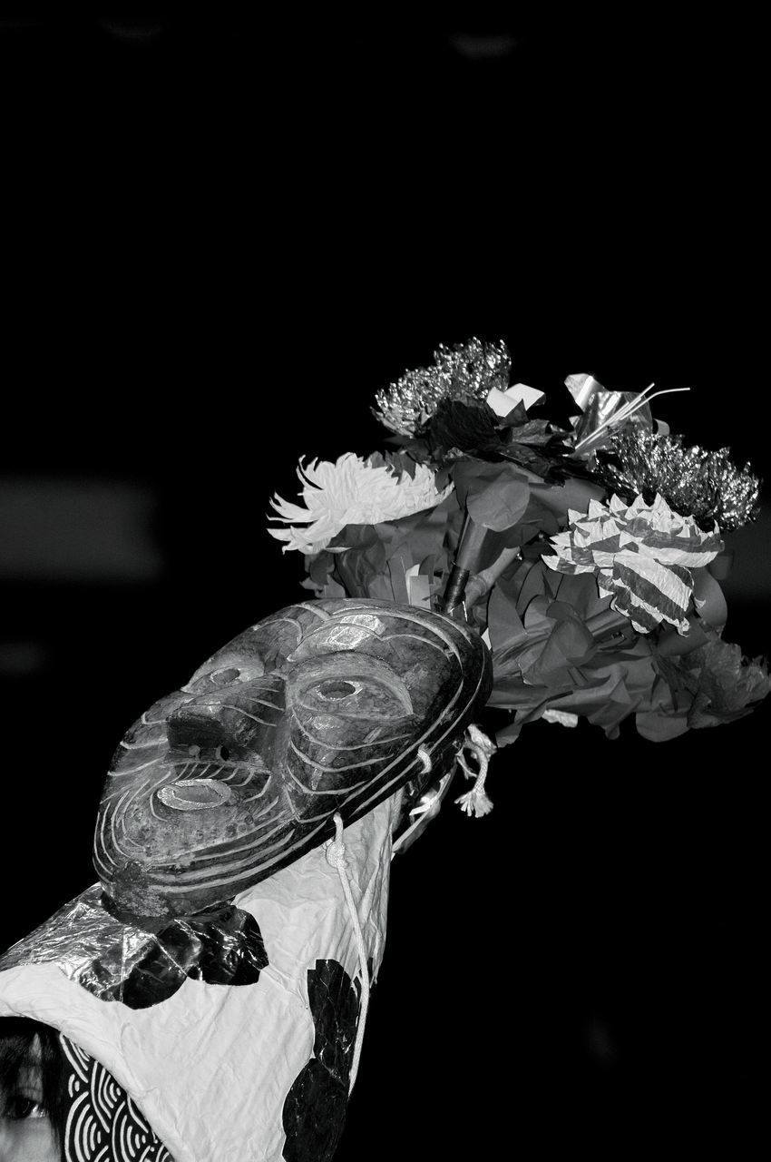 Close-Up Of Mask And Flowers