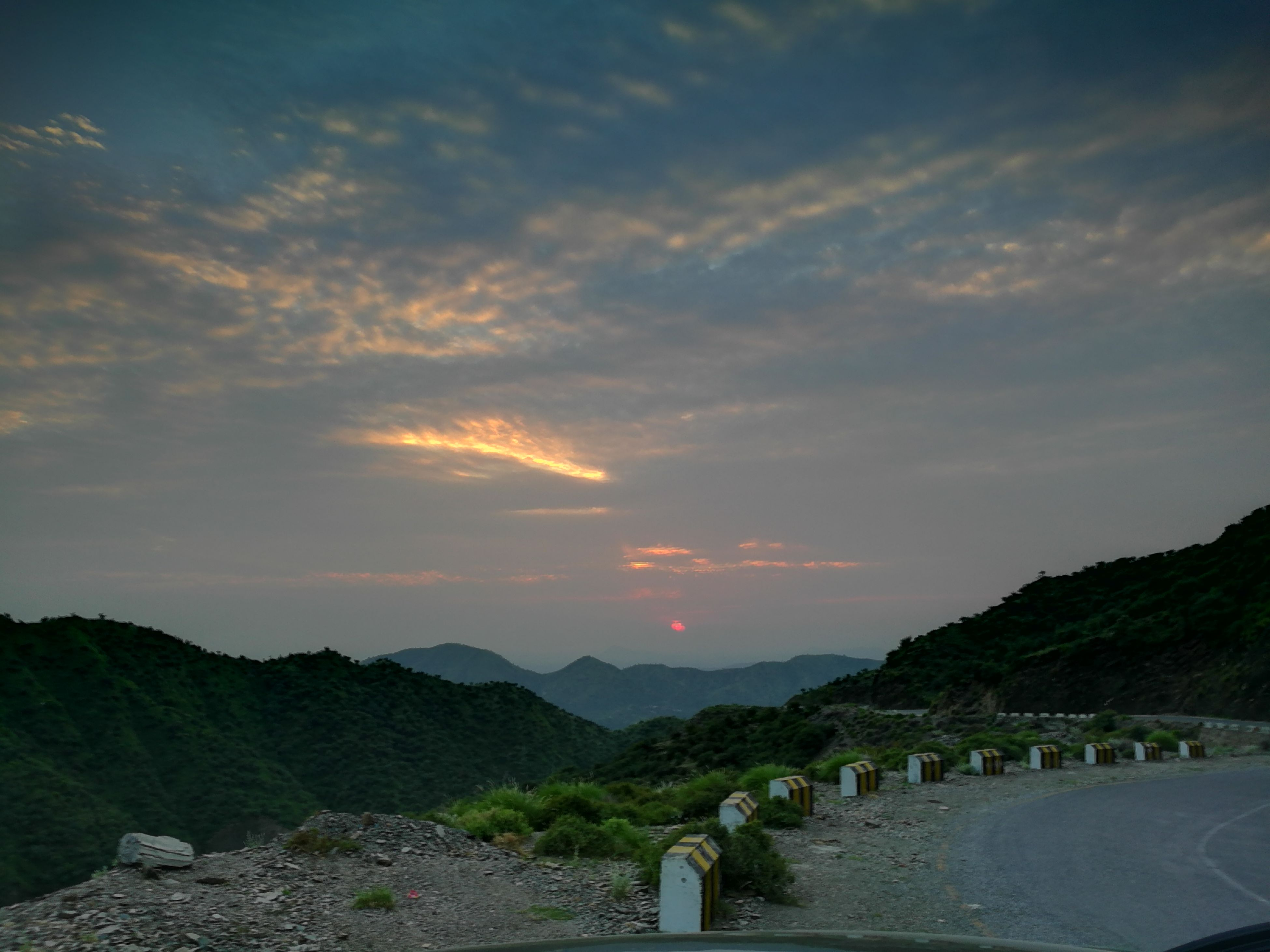 mountain, tranquil scene, mountain range, cloud - sky, sky, tranquility, scenics, water, cloud, outdoors, tourism, non-urban scene, nature, beauty in nature, atmosphere, sun, atmospheric mood, sea, observation point, long, distant