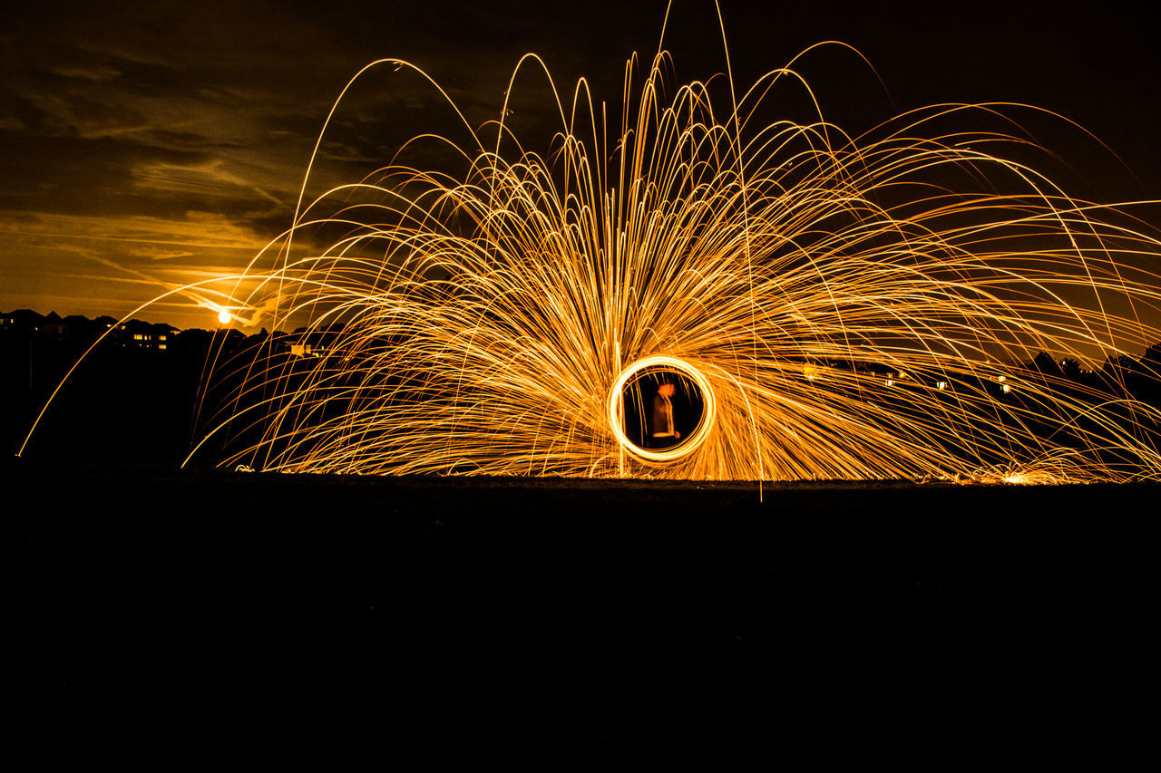 motion, wire wool, long exposure, spinning, night, circle, speed, illuminated, orange color, blurred motion, glowing, danger, outdoors, no people, arts culture and entertainment, sky, nature