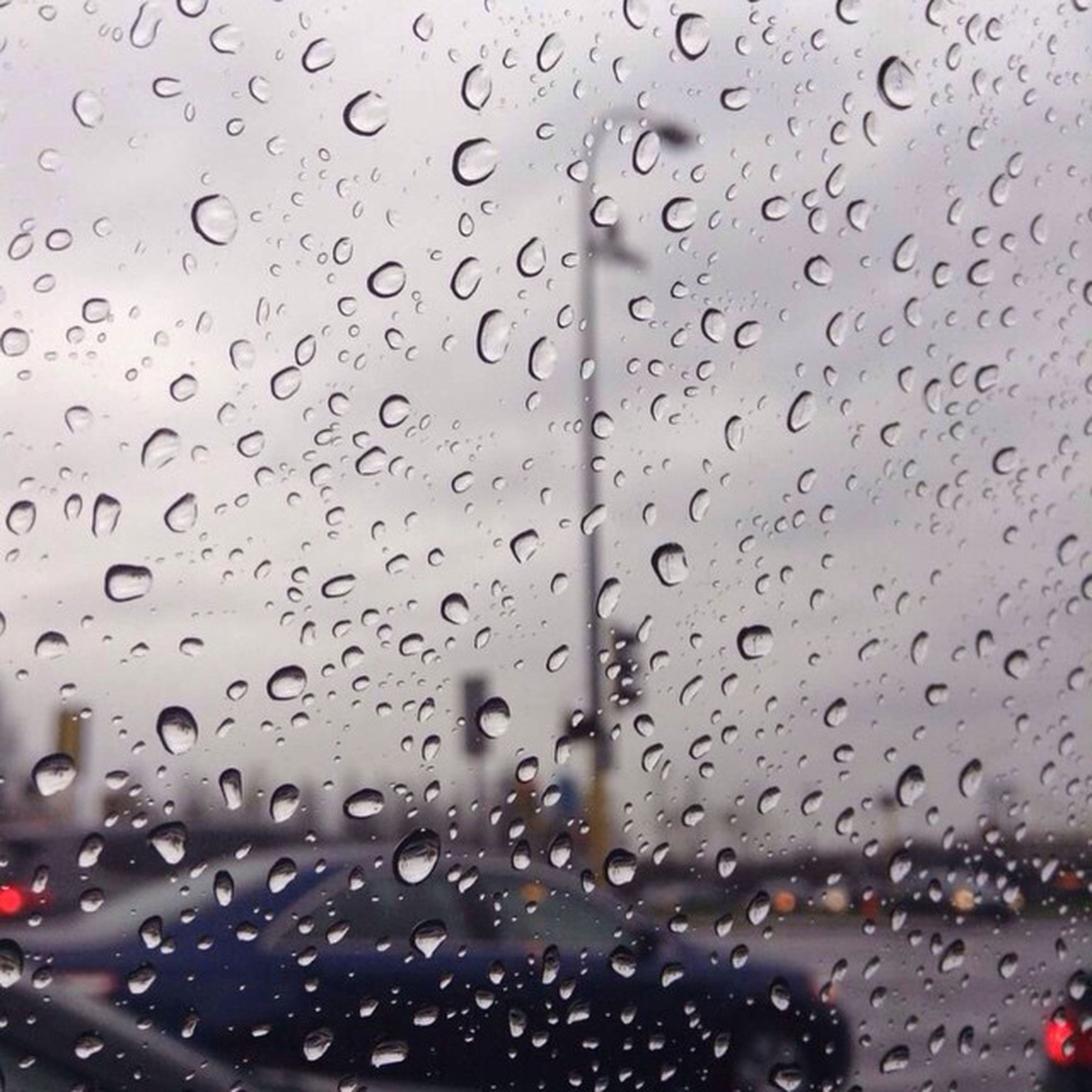 drop, window, rain, mode of transport, land vehicle, weather, season, water, full frame, windshield, backgrounds, road, sky, monsoon, no people, close-up, focus on foreground, droplet, day, nature, overcast