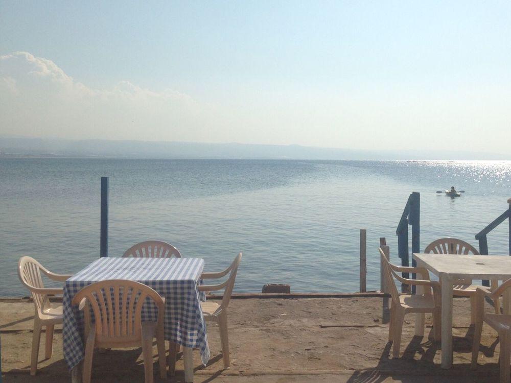 Showcase: November TYR Lebanon Sea And Sky Horizon Smallboat Tables Chairs Sun Seaturtles