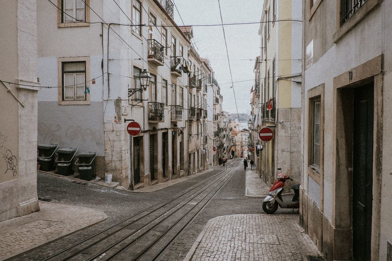 Architecture Building Exterior Built Structure City City Crossroads Day Empty One Person Outdoors Path People Portugues Residential Building Road Road Sign Sky Street The Way Forward Tracks Transportation Vespa Way
