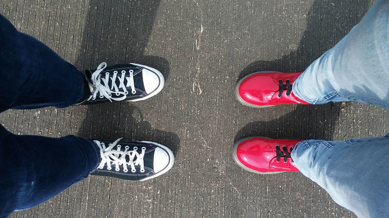 Sisters Bonding Boots Canvas Shoe Converse Experience Family Girls Human Body Part Human Leg Lifestyles Limb Love Low Section Outdoors Pants Personal Perspective Pink Red Selfie Shoe Shoes Sisters Standing Togetherness Travel