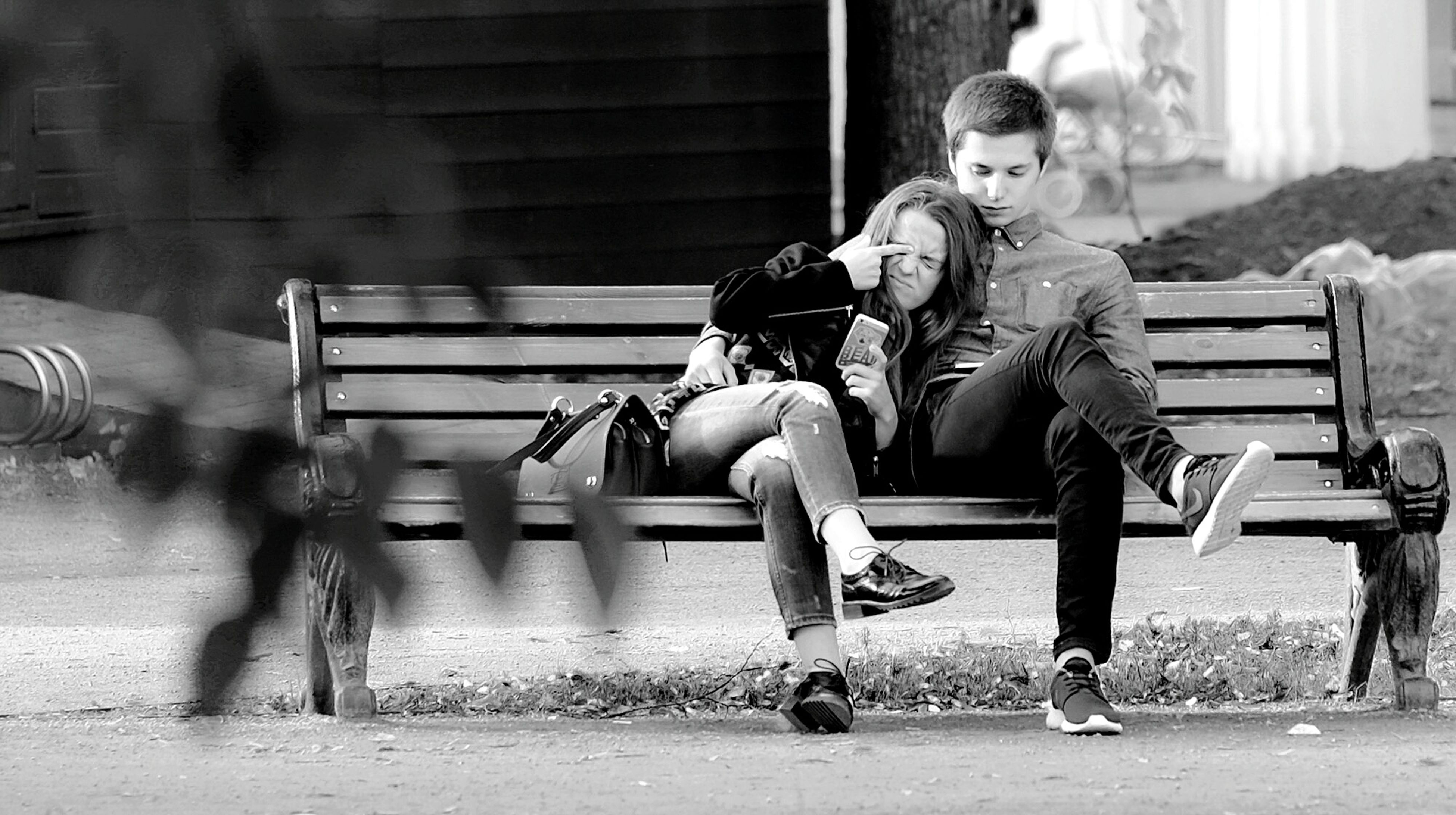 real people, full length, sitting, casual clothing, day, two people, lifestyles, outdoors, togetherness, leisure activity, childhood, young adult