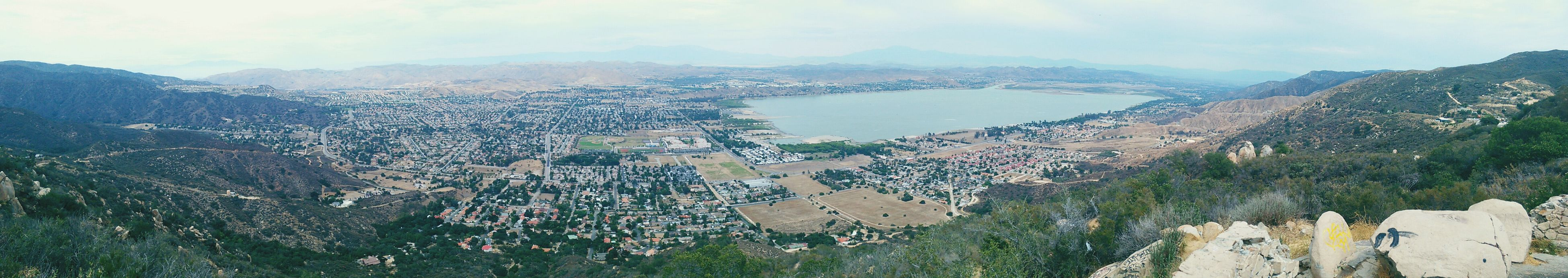 Overlooking Lakeelsinore and the town of Lake Elsinore from the Lookout on Highway 74 aka the Ortega Highway a beautiful but treacherous stretch oh highway beginning in Orangecounty  in the coastal town of Sanjuancapistrano snaking about 35 miles through the Santa Ana mountain range and emerging in Riverside County and the town of Lake Elsinore. It is 3:20 on a Sunfay Afternoon anf the current temperature ia a sweltering 93.2° F and Humidity is 27%. Elevation is 2469 ft. Panoramic View Panoramic Landscape Panoramic Photography Riversidecounty Inlandempire