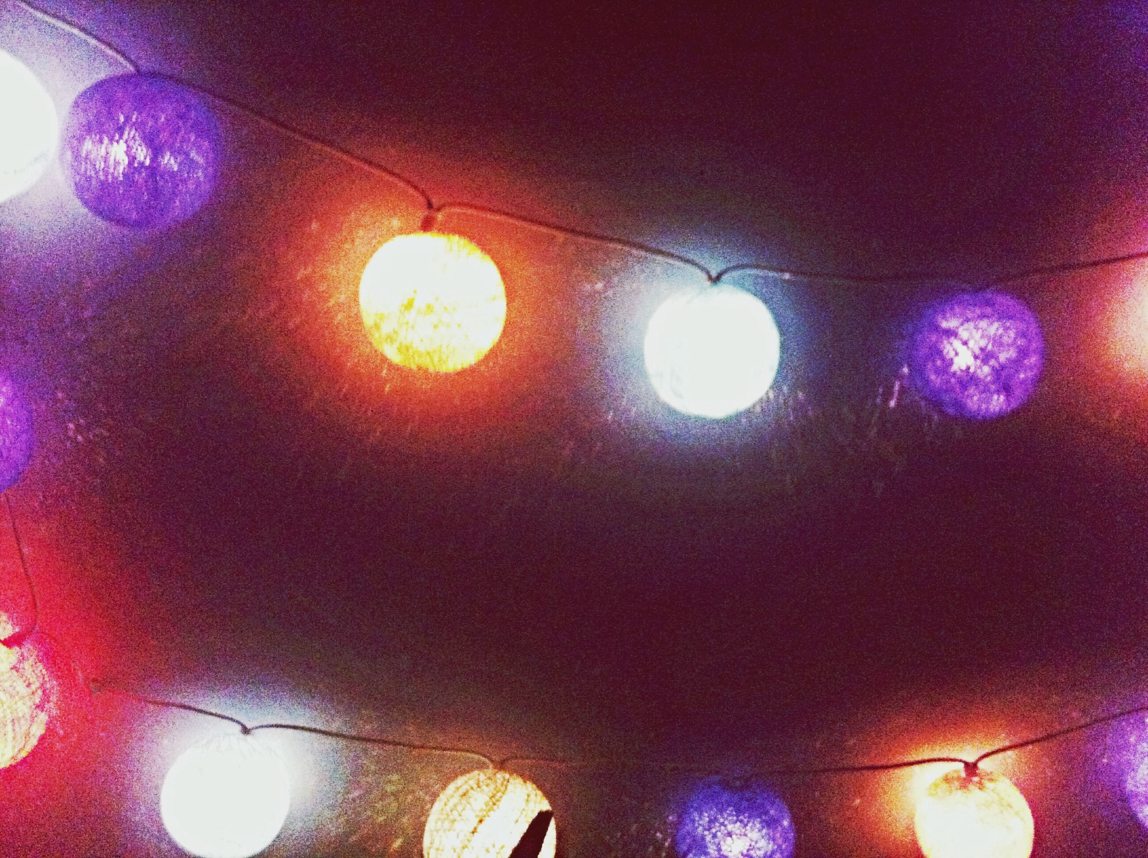indoors, illuminated, lighting equipment, ceiling, low angle view, decoration, pattern, multi colored, electric light, hanging, circle, electricity, wall - building feature, light - natural phenomenon, design, backgrounds, glowing, no people, electric lamp, built structure