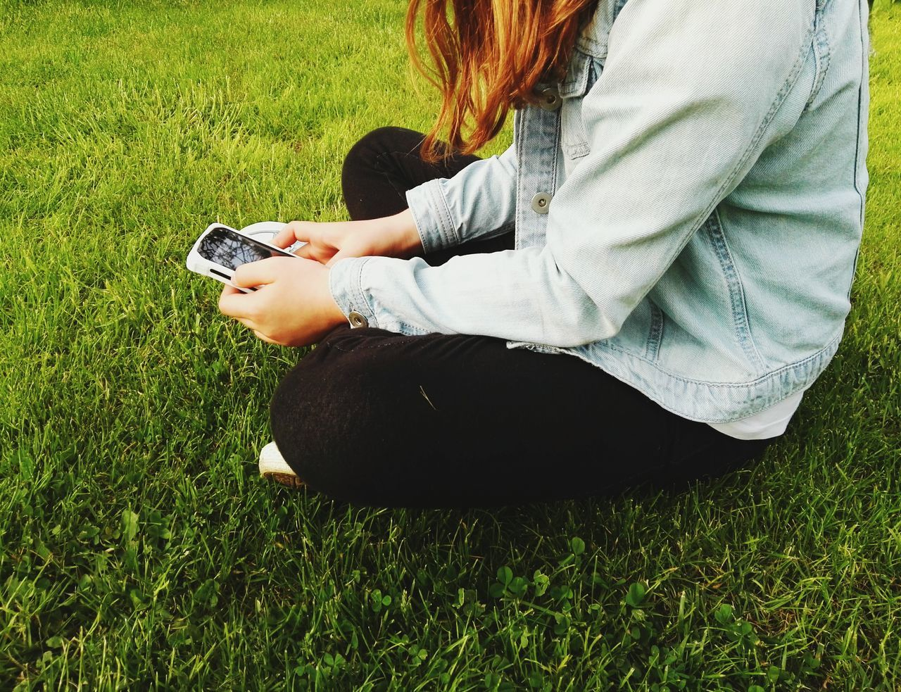 Technology and nature Grass One Person One Woman Only People Only Women Casual Clothing Leisure Activity Human Body Part One Young Woman Only Young Women Sitting Relaxation Real People Outdoors Technology And Nature Technology Photography Smartphone Photography Childhood Child And Technology