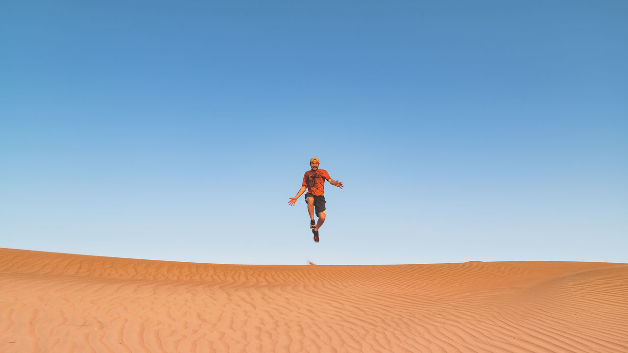Clear Sky Desert Desert Fun Jumping Man Nature Oman One Person Sand Sand Dune Wahiba Sands Live For The Story
