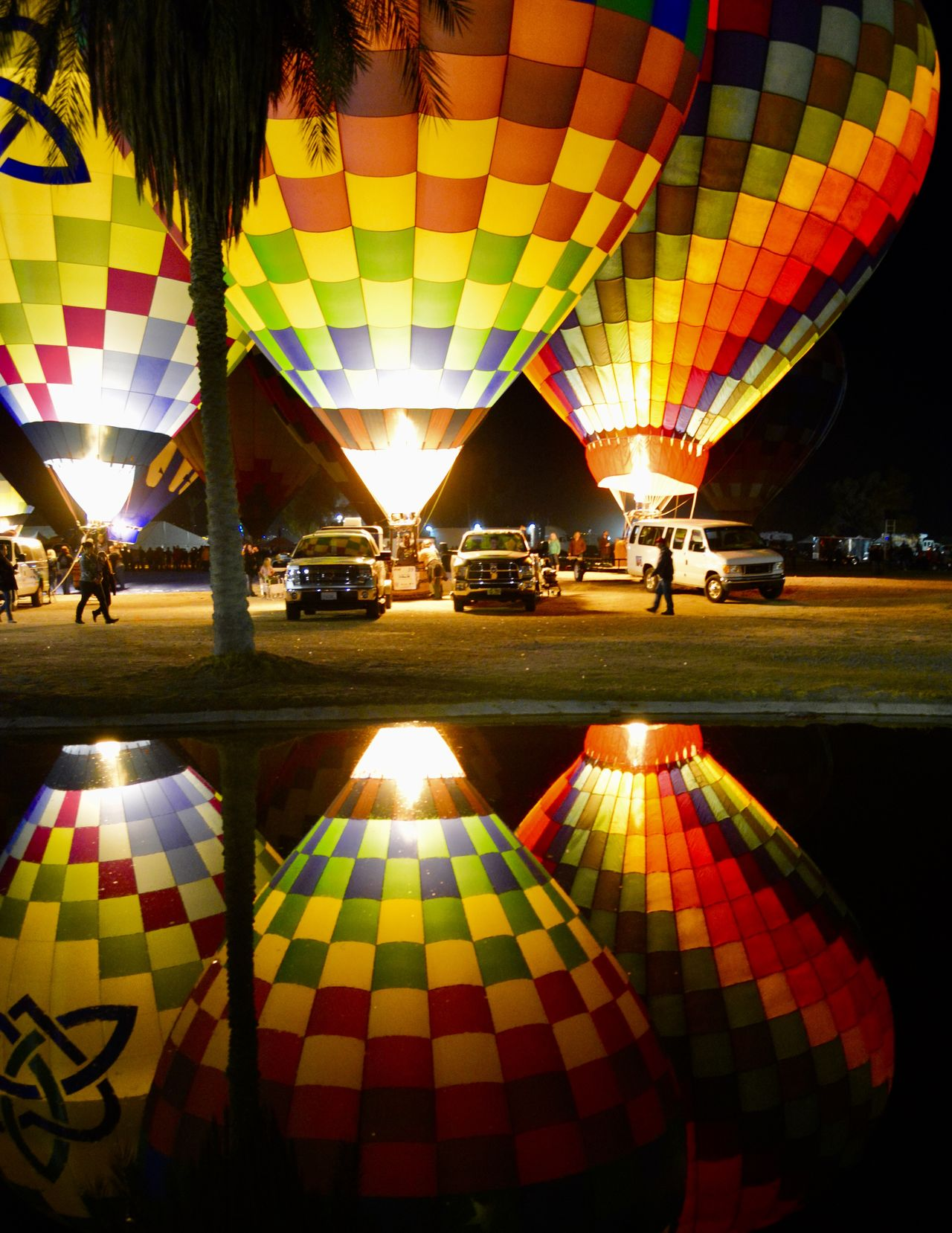 Hot air balloon festival~mom loved it,we didnt know it would be her last ~ Arizona Celebration Hot Air Balloons Illuminated Lighting Equipment Multi Colored Night Night Lights Reflection