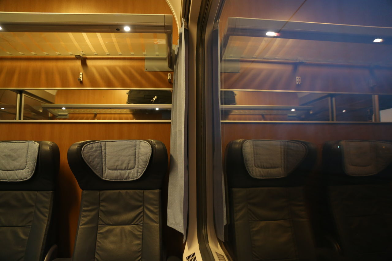 Illuminated Indoors  Mirror Image No People Seats Train Train Compartment Transportation