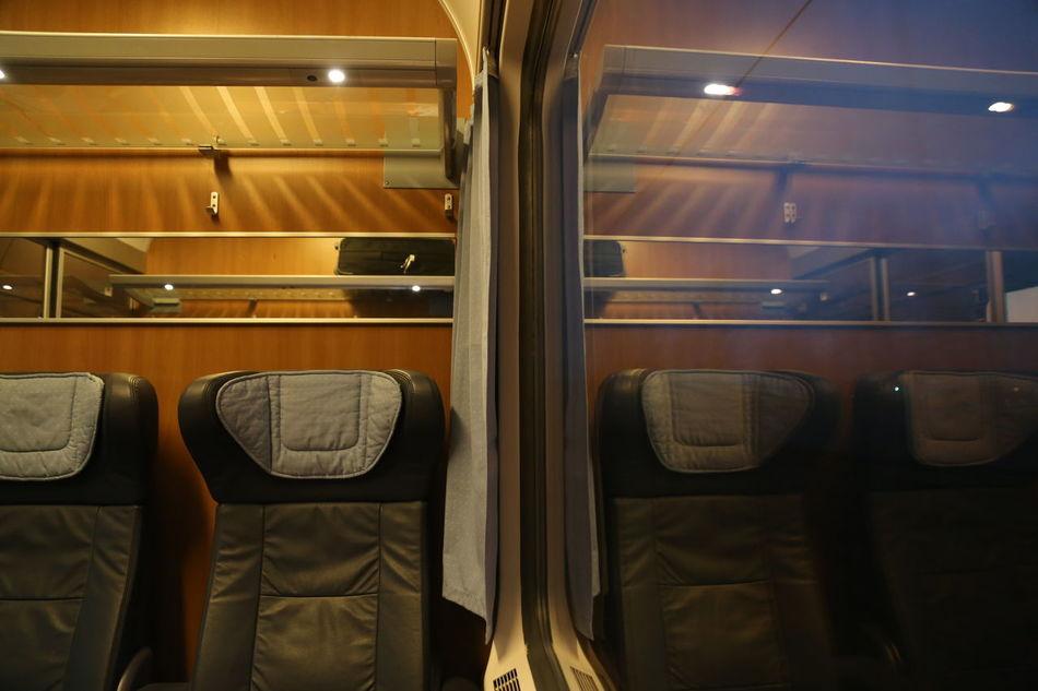 Illuminated Indoors  Mirror Image No People Seats Train Train Compartment Transportation