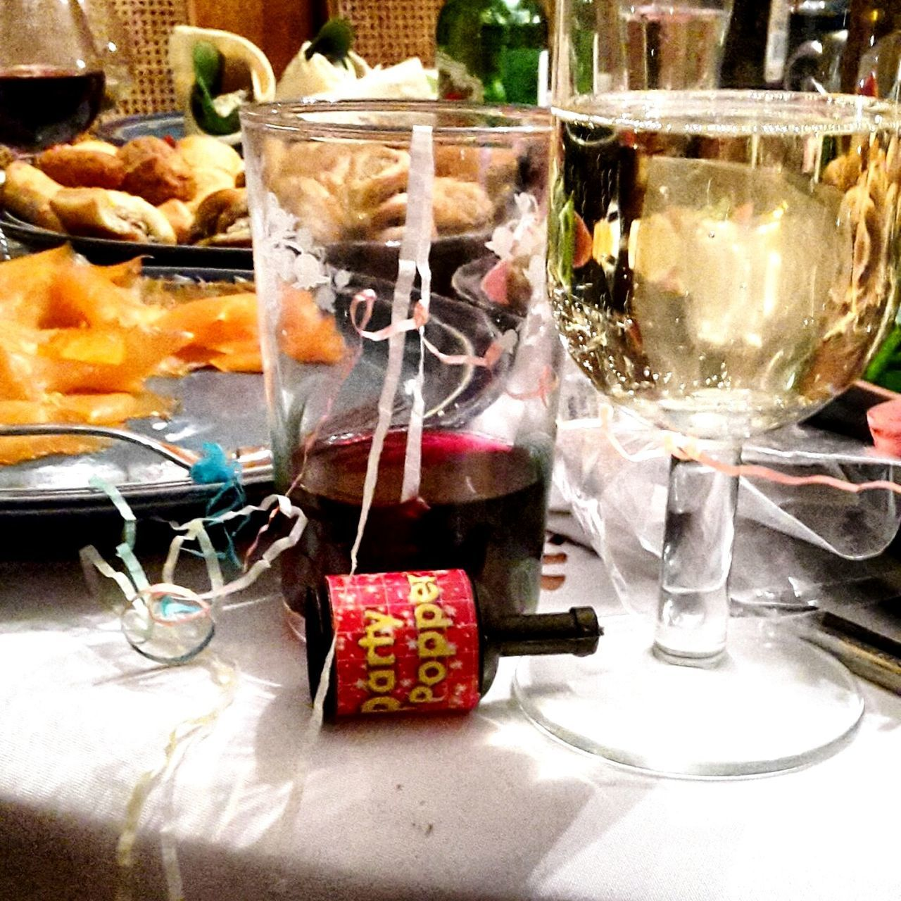 Close-Up Of Wine And Champagne On Table