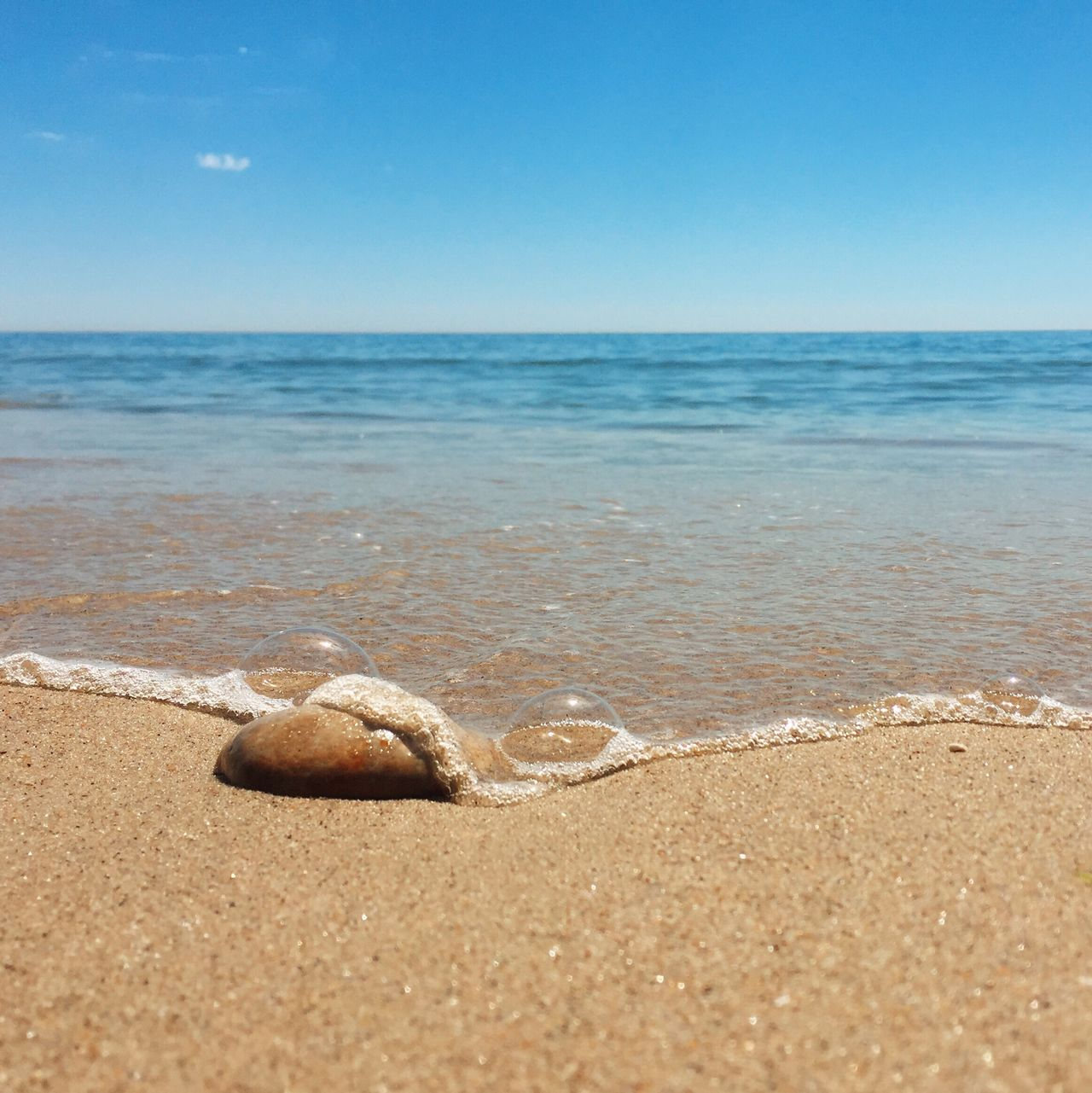 Sand Beach Sea Horizon Over Water Shore Water Tranquil Scene Tranquility Scenics Seascape Coastline Summer Nature Calm Blue Travel Destinations Sky Surface Level Beauty In Nature Vacations