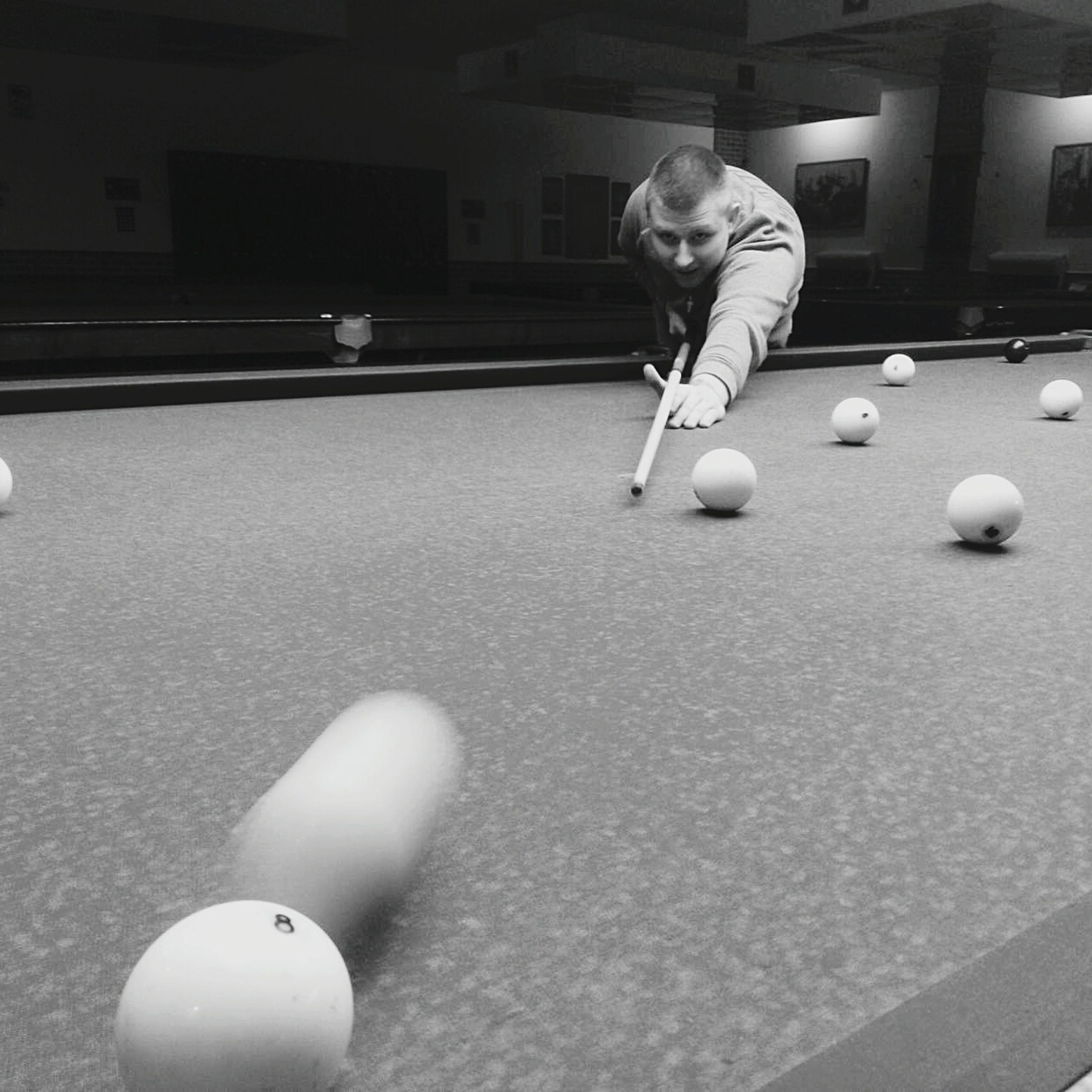 pool ball, pool table, pool - cue sport, playing, leisure activity, ball, sport, real people, snooker, pool cue, indoors, one person, lifestyles, leisure games, cue ball, concentration, snooker ball, pool hall, young adult, snooker and pool, day, people