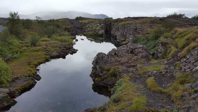 Beauty In Nature Cloud - Sky Flowing Geology Green Color Nature Non-urban Scene Physical Geography Reflection Remote Rock - Object Rock Formation Scenics Sky Standing Water Stream Thingvellir National Park Tourism Tranquil Scene Tranquility Travel Destinations Vacations Water Waterfront þingvellir