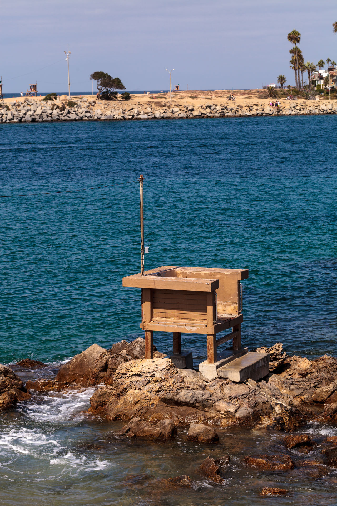 Fishing stand in the harbor of Corona del Mar, California in summer Blue Building Exterior California Corona Del Mar Day Fishing Fishing Post Jetti Nature No People Outdoors Sea Sky