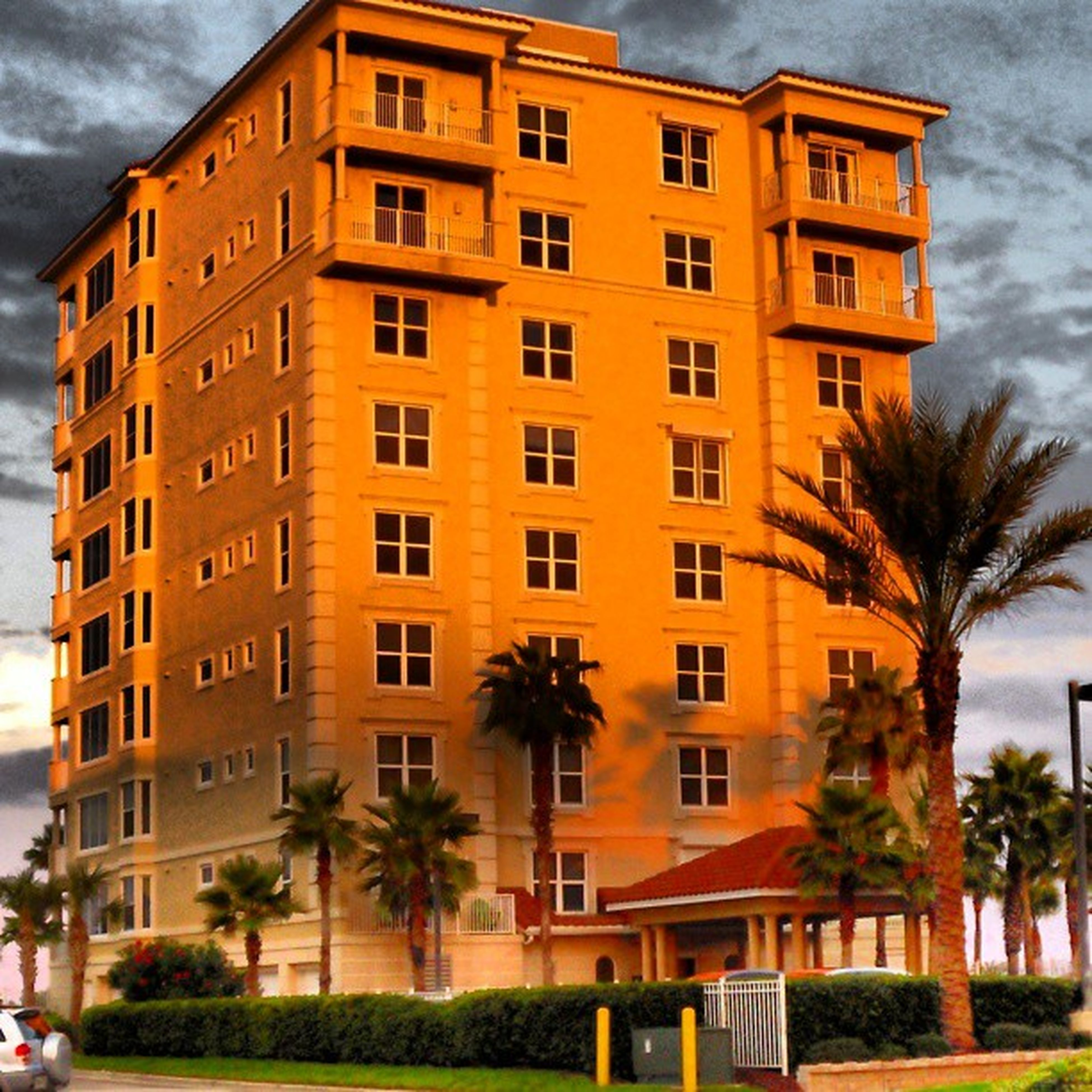 building exterior, architecture, built structure, tree, window, sky, building, city, residential building, residential structure, facade, low angle view, outdoors, day, growth, no people, incidental people, house, cloud - sky, lawn