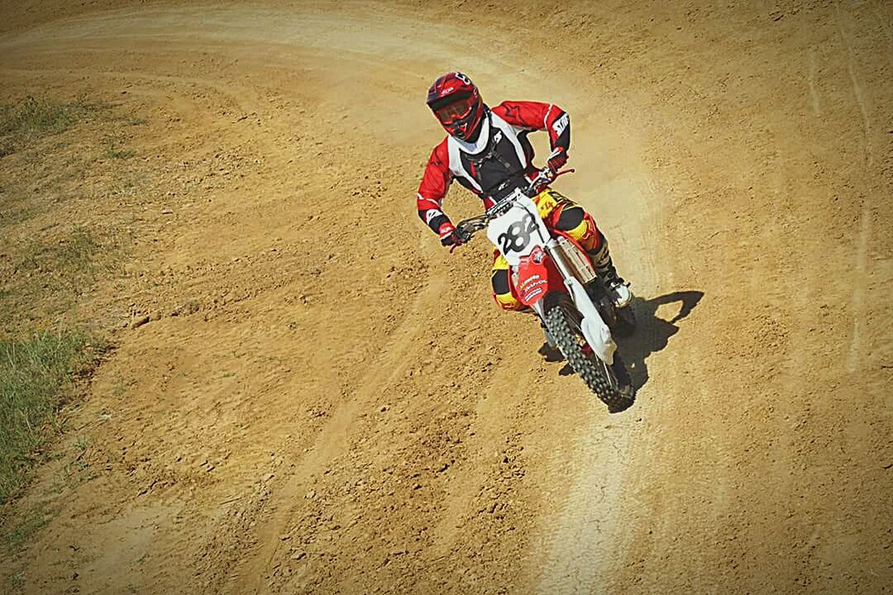 headwear, speed, sports race, adventure, sports helmet, crash helmet, sports track, motocross, high angle view, risk, motorcycle, skill, only men, motorsport, extreme sports, competition, men, outdoors, sport, adult, full length, day, helmet, sports clothing, people, adults only, one person, sand dune, competitive sport, one man only