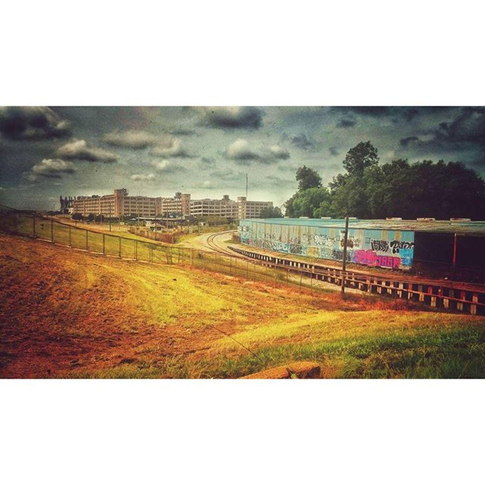 Neworleans Usnaval Graffiti Tracks clouds grass levy Louisiana nola