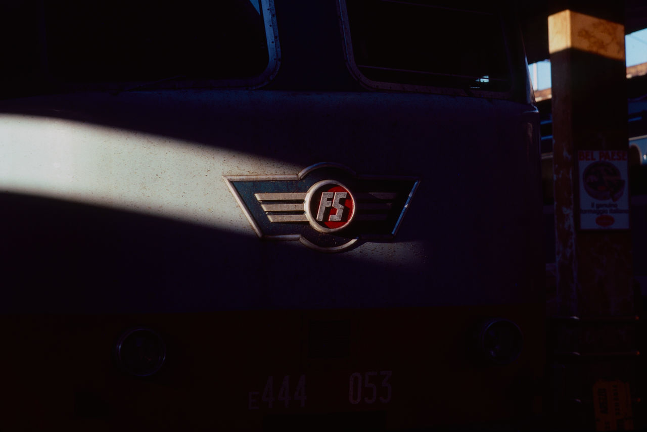 The streak of sunlight that illuminated the FS emblem on the front of the engine was there and gone in seconds. One of my favorite train photos ever. Original shot on Kodachrome Professional, scanned with SilverFast8 software. Florence Italy Locomotive Shadow Sun Streaks Sunlight And Shadow Train Station Transportation