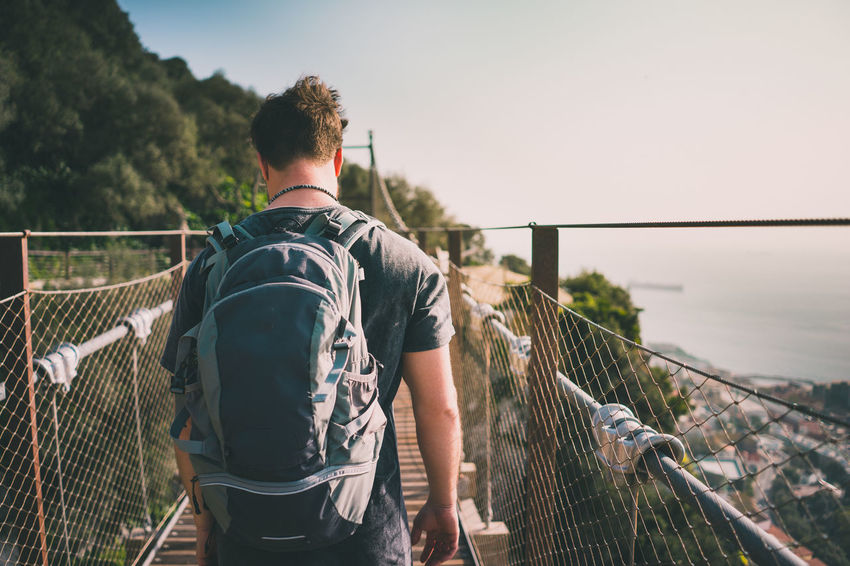 Man passing a hanging bridge SPAIN Travel Adult Back Pack Bridge Bridge - Man Made Structure Day Footbridge Gibraltar Hanging Bridge Leisure Activity Live Authentic Men Nature One Person Outdoors People Real People Rear View Sky Standing Tree Walking Water Young Adult